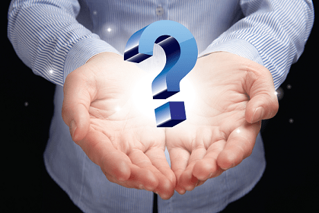 image showing two hands holding a question mark floating in air.