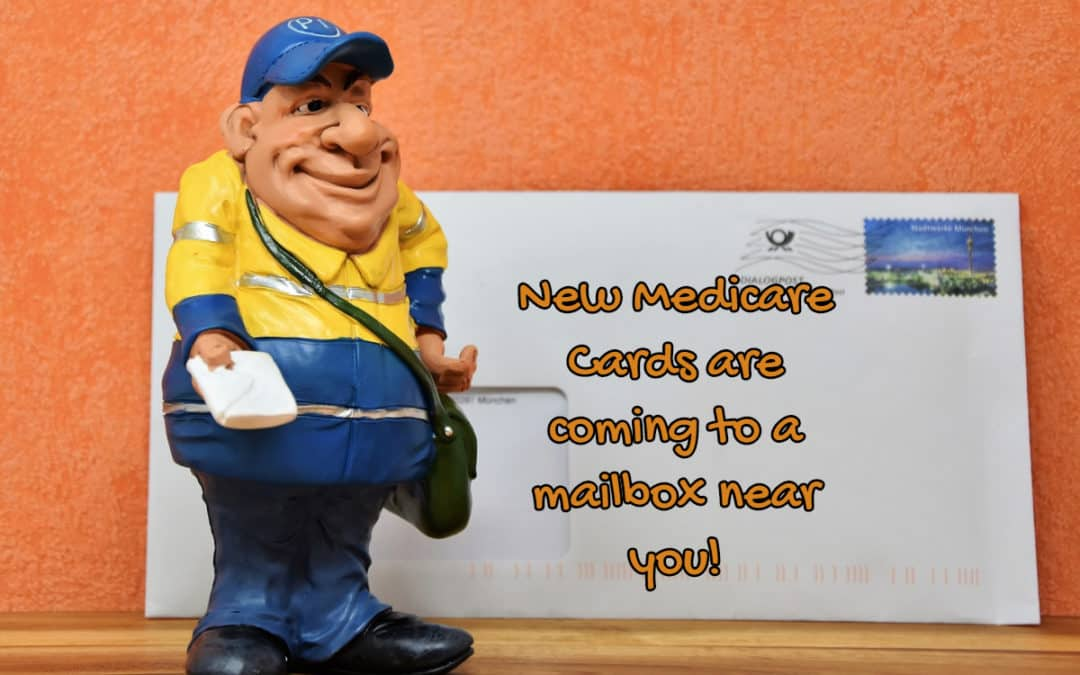 "a toy mailman with writing, ""New Medicare cards are coming to a mailbox near you"", and an envelope with a blue stamp."