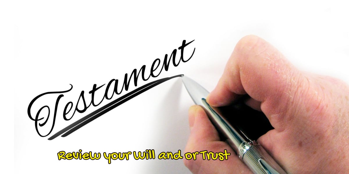 "image of someone writing the word ""testament"" to depict Review your Will or Trust when turning 65."