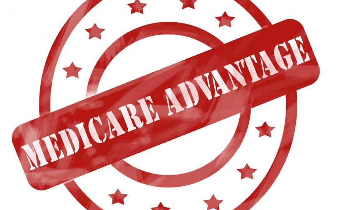 (c) A red ink weathered roughed up circles and stars stamp design with the words MEDICARE ADVANTAGE on it.
